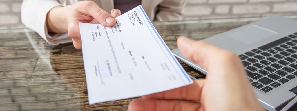 Class Action Funds Recovery | man handing a check to another man | SIB Fixed Cost Reduction
