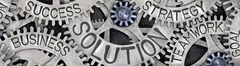 Solutions | Gears with biz words etched in | SIB
